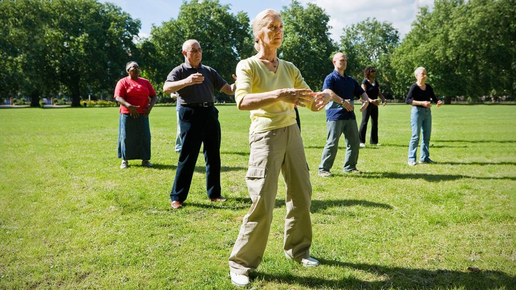 Older adults practicing Tai Chi outside